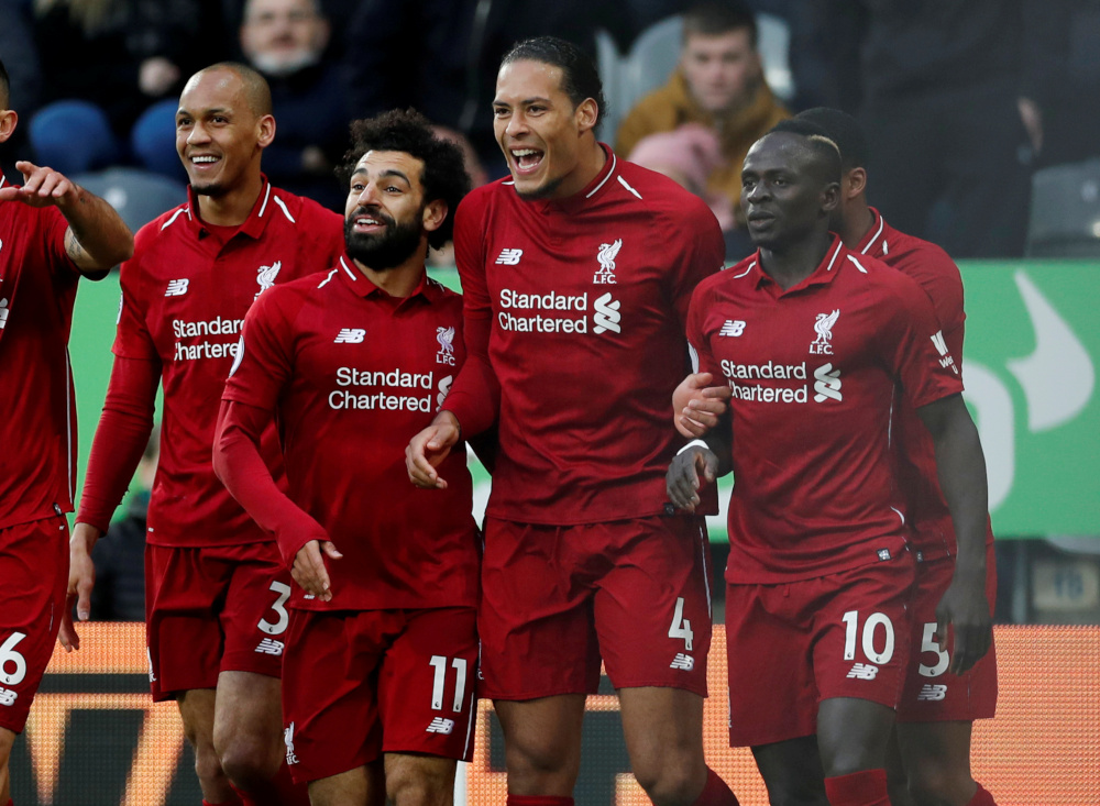 Liverpool's Virgil van Dijk celebrates scoring their first goal with Mohamed Salah, Sadio Mane and team mates during the Premier League match against Newcastle United at St James' Park, Newscastle, Britain, May 4, 2019. — Action Images via Reuters
