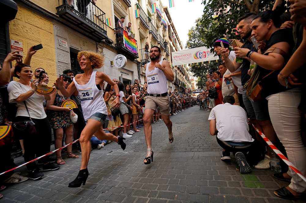 Contestants take part in the annual race on high heels during Gay Pride celebrations in the quarter of Chueca in Madrid, Spain July 4, 2019. — Reuters pic