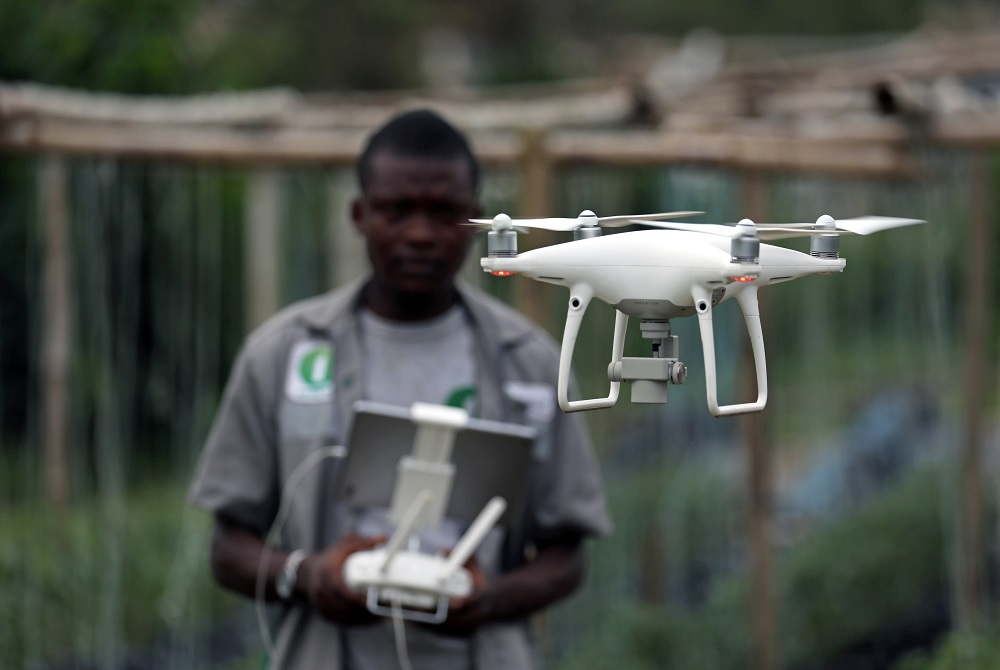 A member of the Ivorian Investiv Group startup, take off a drone at a tomatoes farm in northern Abidjan, Ivory Coast April 26, 2019. — Reuters pic
