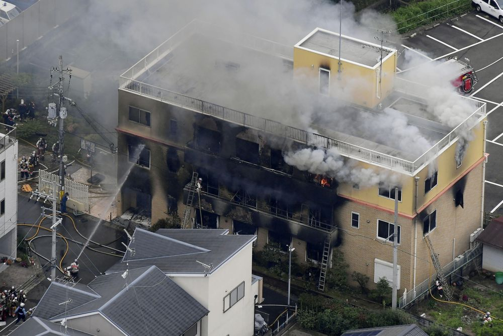An aerial view shows firefighters battling fires at the site where a man started a fire after spraying a liquid at a three-story studio of Kyoto Animation Co in Kyoto, Japan, July 18, 2019. — Kyodo picture via Reuters
