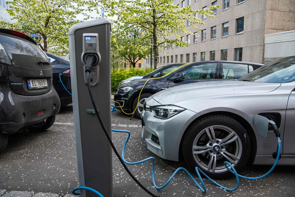 Electric cars are being charged on a street in the Norwegian capital Oslo April 30, 2019. — AFP pic