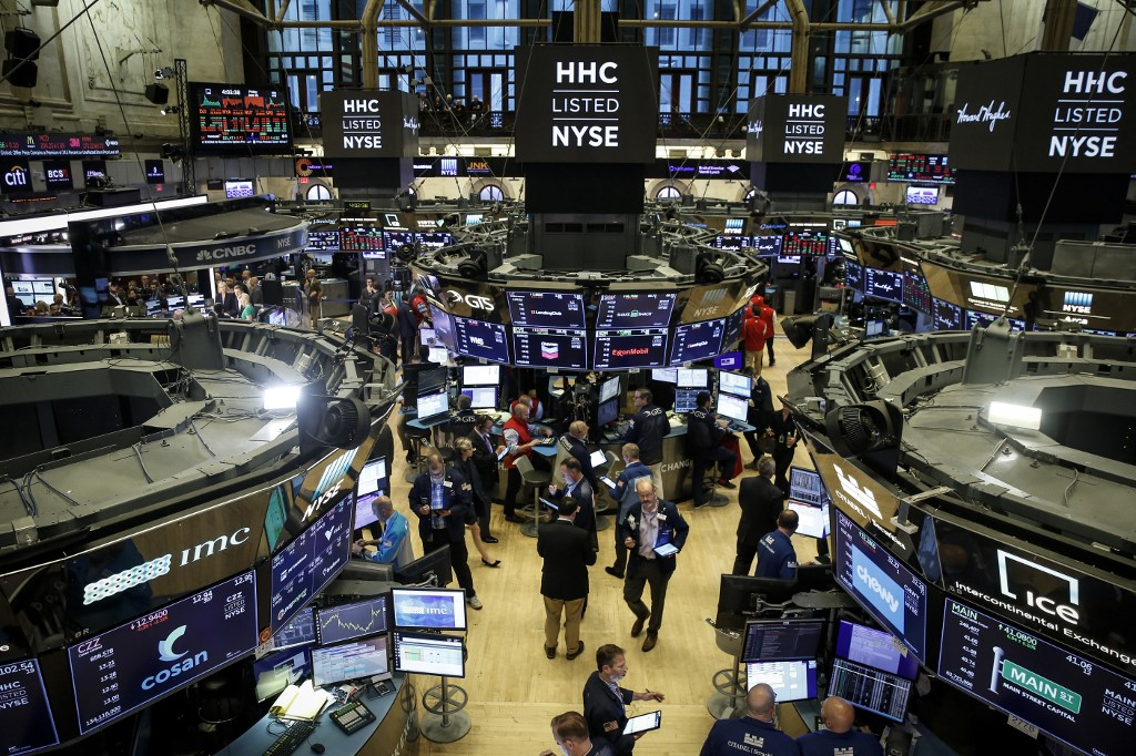 Traders and financial professionals work on the floor of the New York Stock Exchange (NYSE) ahead of the closing bell, June 21, 2019 in New York. — AFP pic