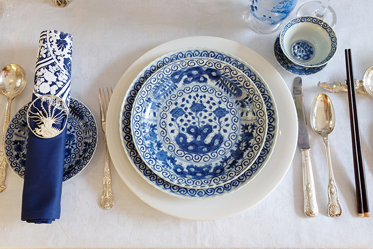 The 19th century Kangxi-style dinner service as part of a modern table setting.