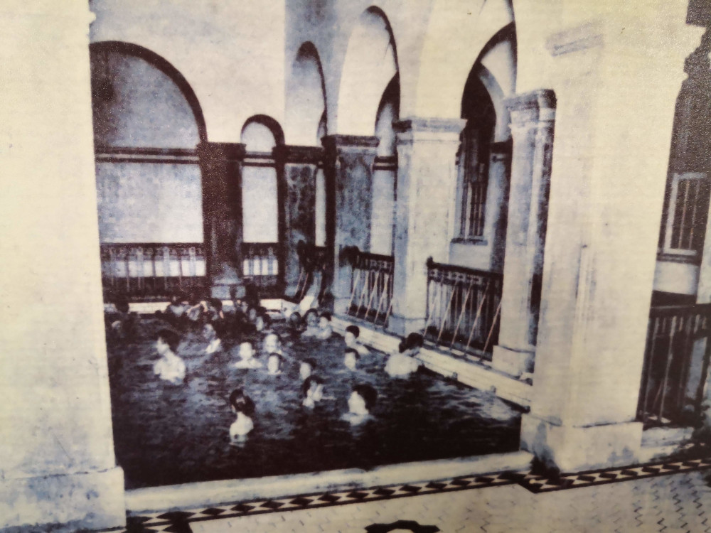 A historical photograph shows the Beitou public bathhouse in use before it was converted into a museum in Taipei, Taiwan.