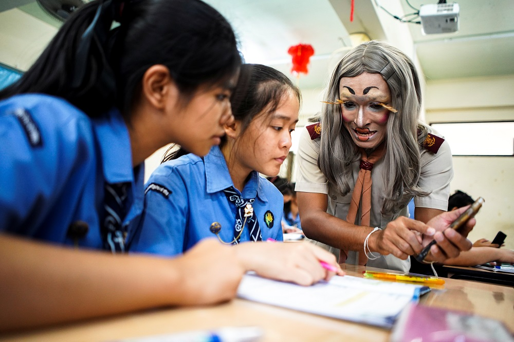 Teerapong Meesataya, 29, known as teacher Bally teaches English in a classroom at the Prasartratprachakit School in Ratchaburi Province, Thailand July 10, 2019. — Reuters pic