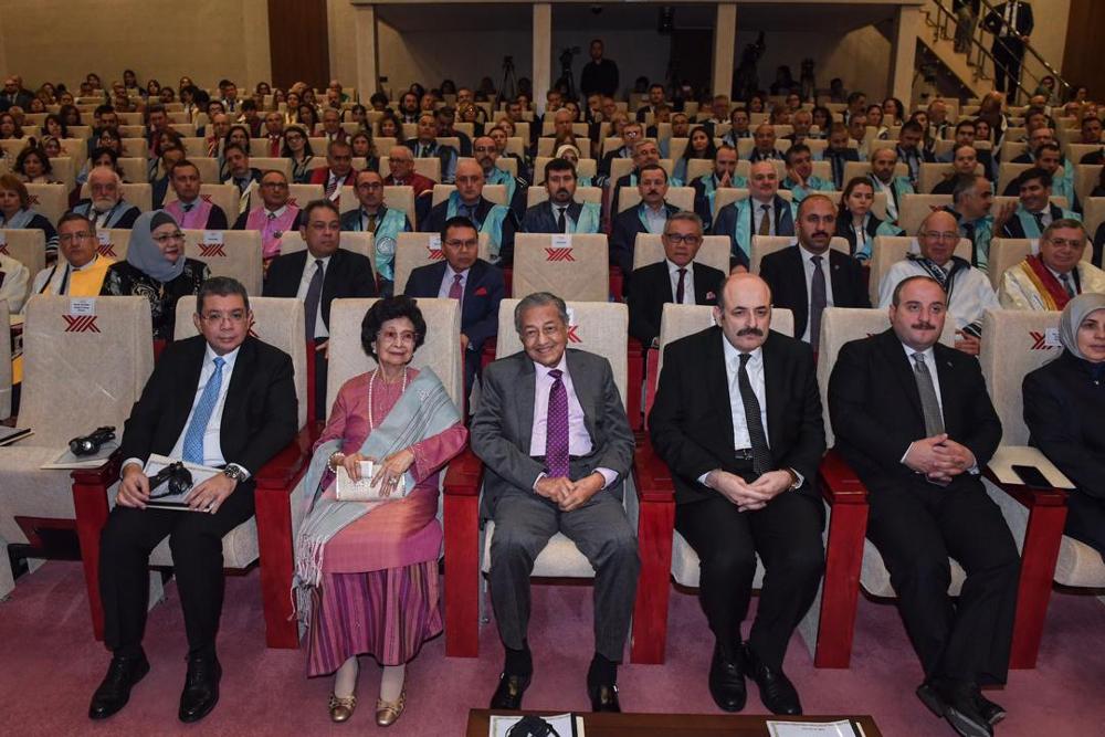 Tun Dr Mahathir Mohamad, Tun Dr Siti Hasmah Mohd Ali and Foreign Minister Saifuddin Abdullah attend a ceremony at the Ankara Yildirim Beyazit University in Ankara July 25, 2019. — Bernama pic