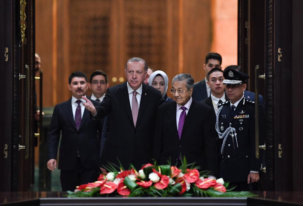 Prime Minister Tun Dr Mahathir Mohamad and Turkish President Recep Tayyip Erdogan arrive for a meeting at the Presidential Complex in Ankara July 25, 2019. — Bernama pic