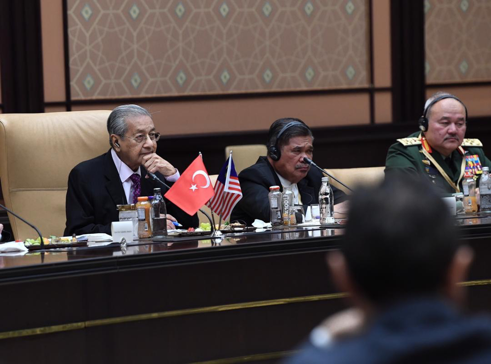 Prime Minister Tun Dr Mahathir Mohamad and Defence Minister Mohamad Sabu during a meeting with their Turkish counterparts at the Presidential Complex in Ankara July 25, 2019. — Bernama pic