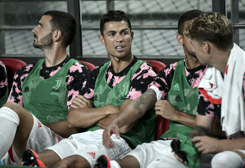Cristiano Ronaldo (centre) sits on the team bench prior to Juventus' friendly football match with Team K League in Seoul July 26, 2019. — AFP pic