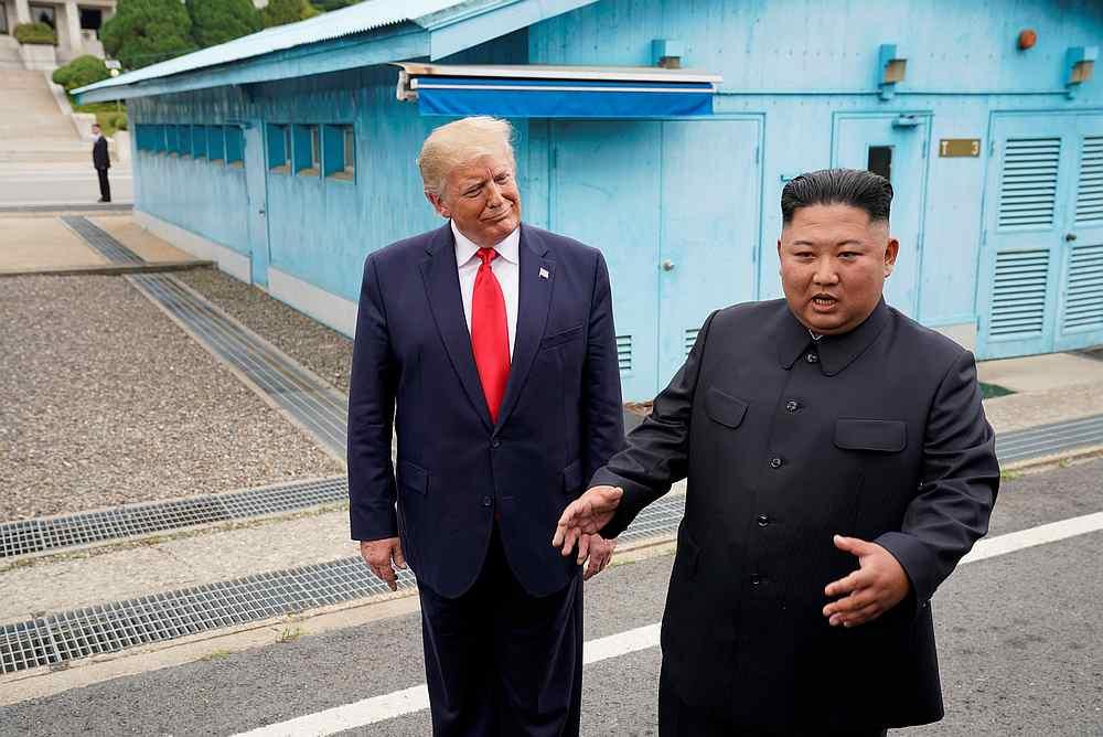 US President Donald Trump meets with North Korean leader Kim Jong-un at the demilitarised zone separating the two Koreas, in Panmunjom, South Korea June 30, 2019. — Reuters pic