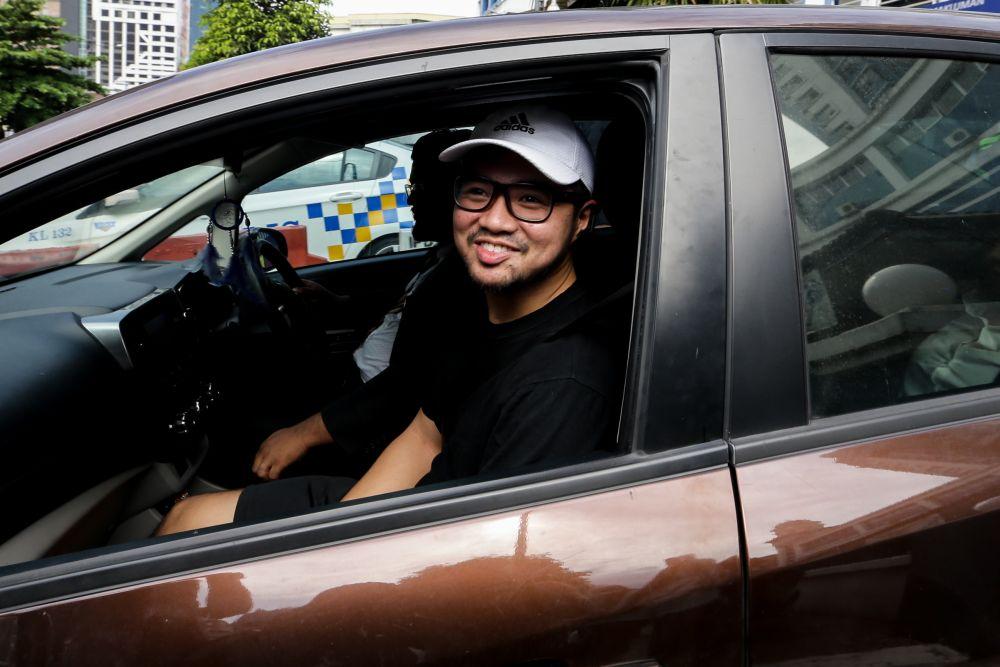 Haziq Abdullah Abdul Aziz is pictured leaving the Dang Wangi police station in Kuala Lumpur July 23, 2019. ― Picture by Ahmad Zamzahuri
