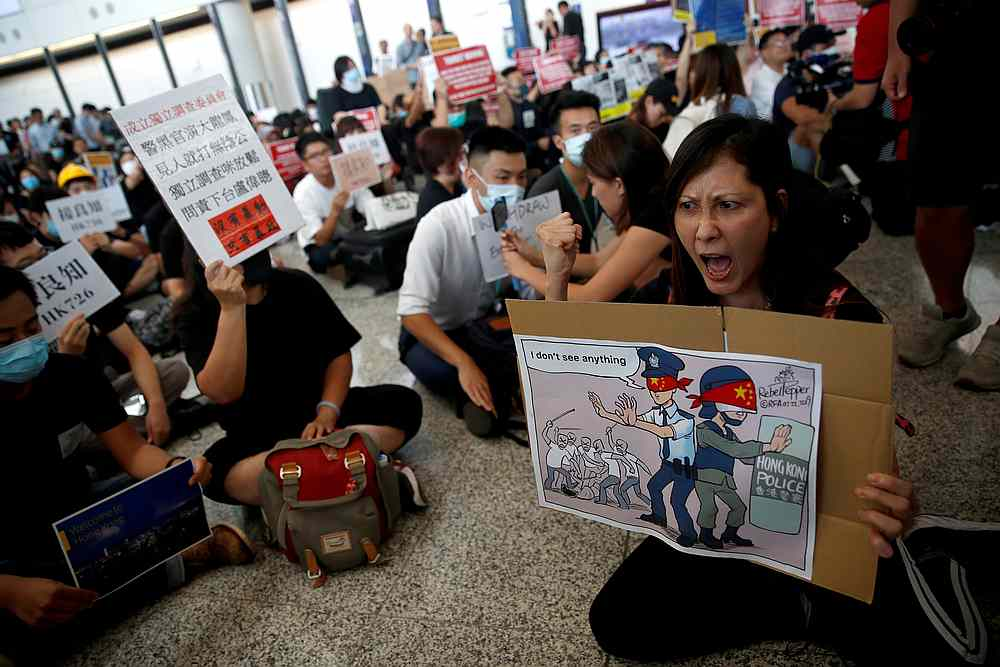 Protesters and members of the aviation industry stage a protest against the recent violence in Yuen Long, at Hong Kong airport July 26, 2019. — Reuters pic
