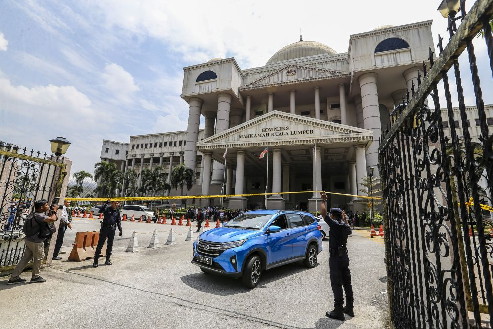 Police cordon off the Kuala Lumpur Court Complex with yellow tape following a bomb threat July 25, 2019. ― Picture by Firdaus Latif