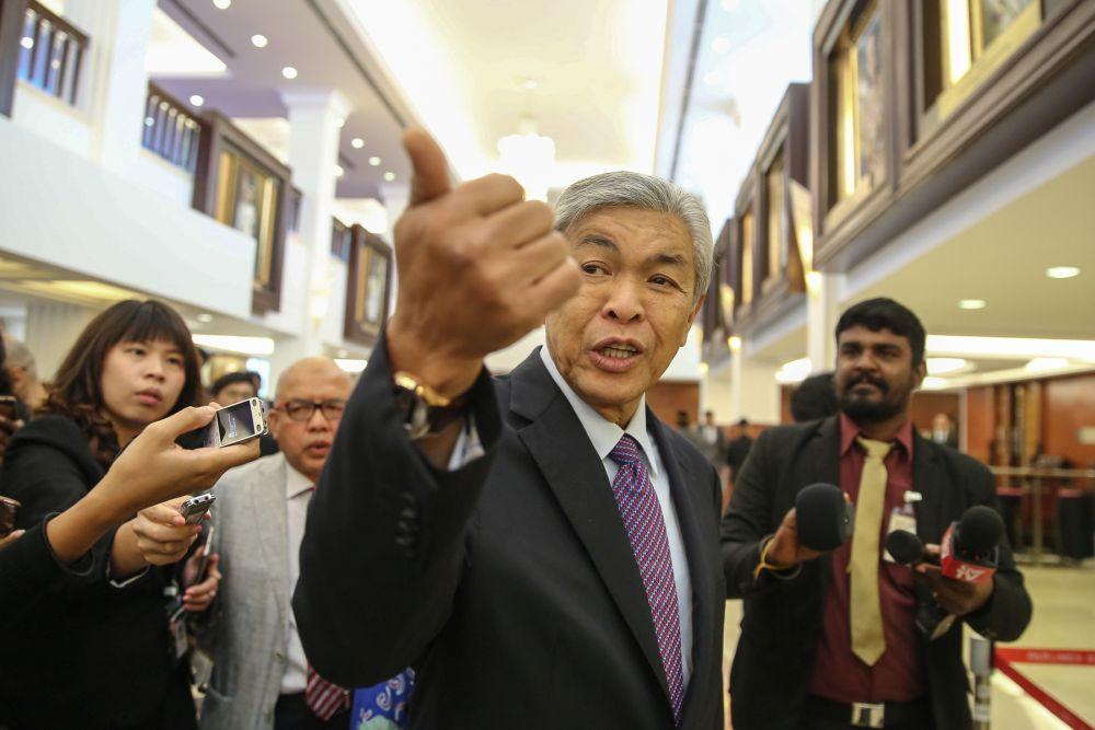 Datuk Seri Ahmad Zahid Hamidi speaks to reporters at Parliament in Kuala Lumpur July 11, 2019. — Picture by Yusof Mat Isa