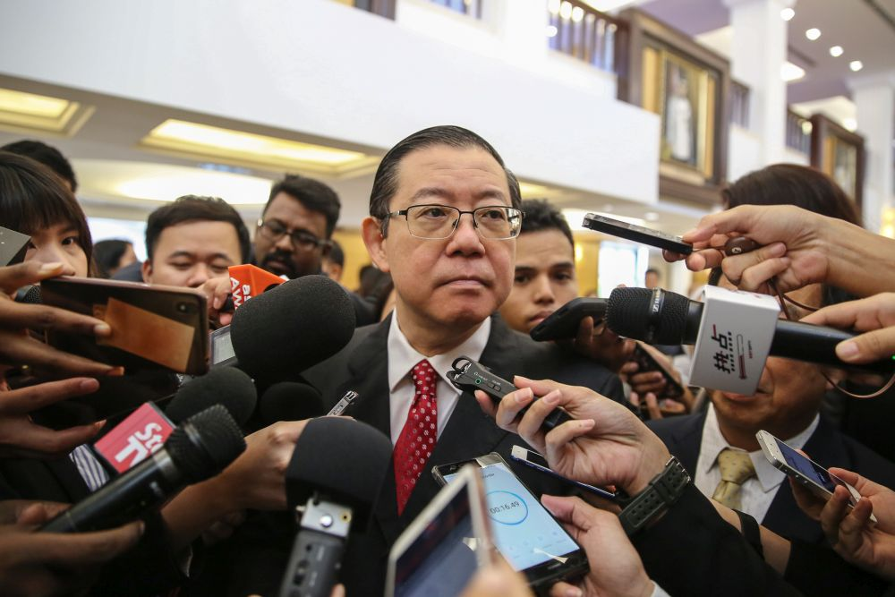 Finance Minister Lim Guan Eng speaks to reporters at Parliament in Kuala Lumpur July 11, 2019. — Picture by Yusof Mat Isa