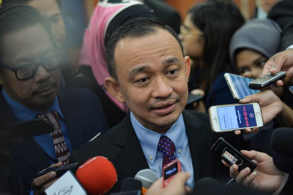 Education Minister Maszlee Malik speaks to reporters at Parliament in Kuala Lumpur July 18, 2019. ― Picture by Mukhriz Hazim