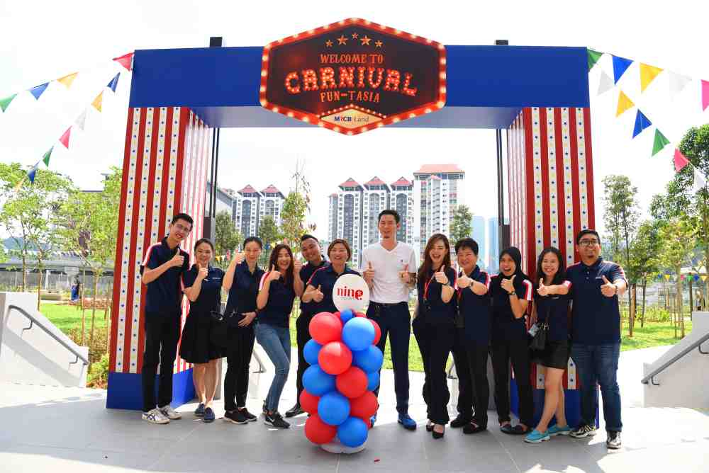 MRCB Land chief executive officer Raymond Cheah (in white) with the MRCB Land team at the launch of Carnival Fun-Tasia at 9 Seputeh Condominium. — Picture courtesy of MRCB Land