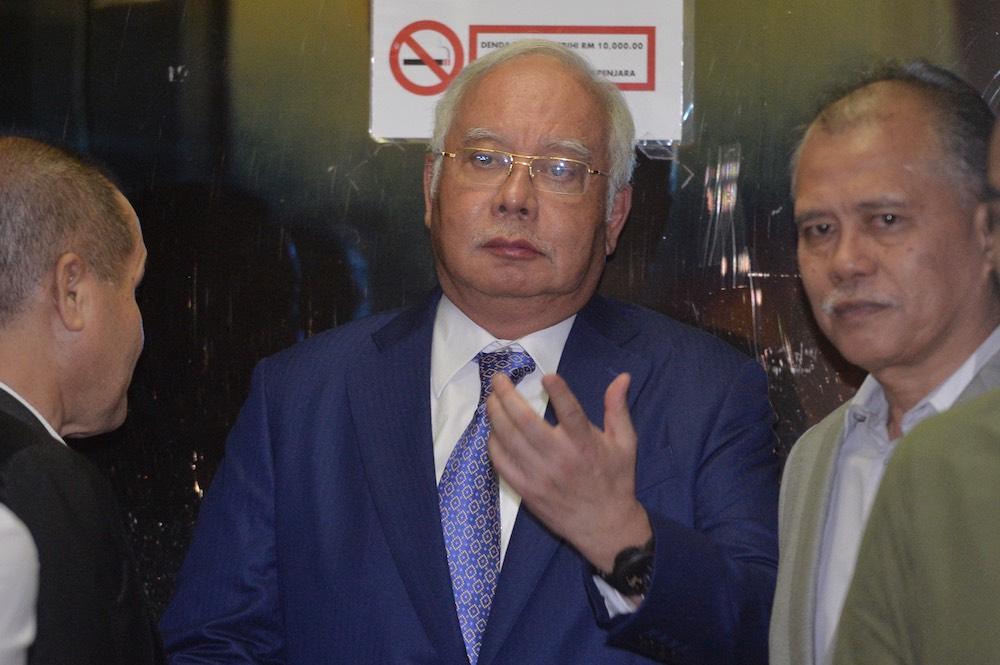 Former prime minister Datuk Seri Najib Razak leaves the Kuala Lumpur Court Complex July 16, 2019. — Picture by Mukhriz Hazim