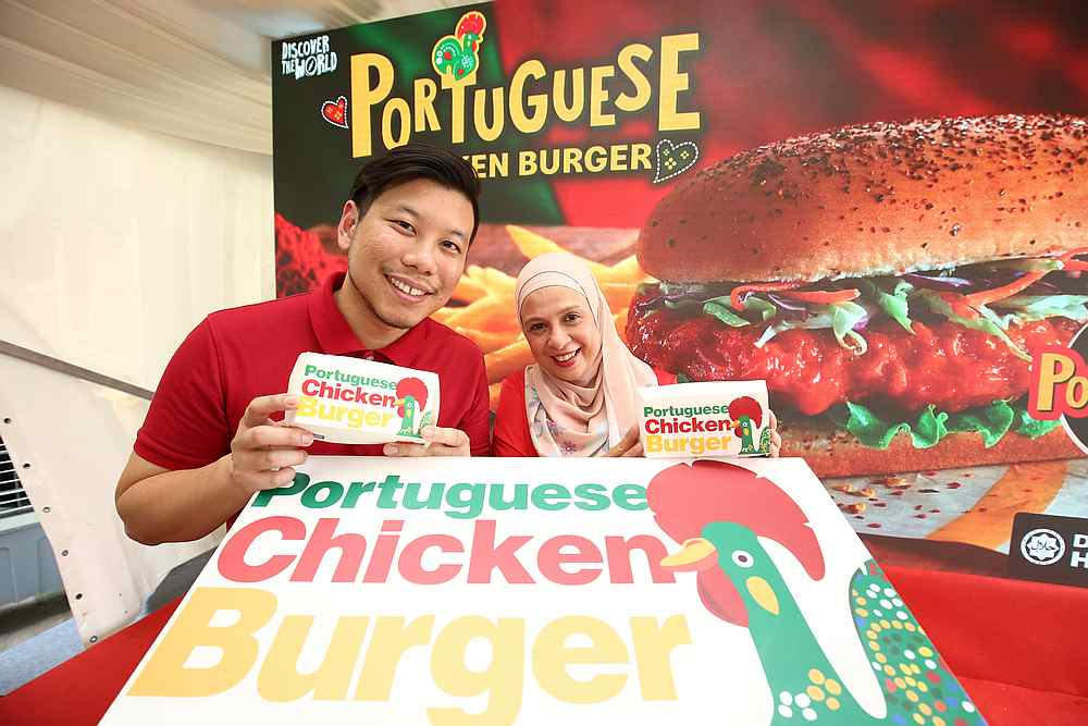 McDonald's Malaysia marketing director Eugene Lee (left) and vice president and chief marketing officer Melati Abdul Hai unveil the Portuguese Chicken Burger. — Picture courtesy of McDonald's Malaysia