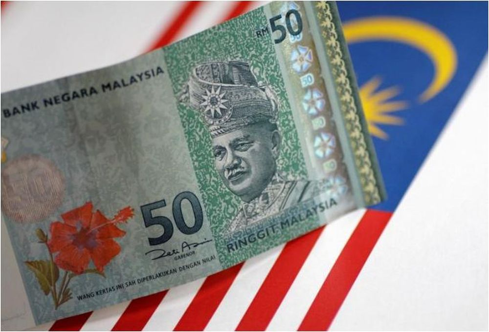The ringgit opens is a seven-month high against a US dollar that is losing ground against major currencies. — Reuters pic