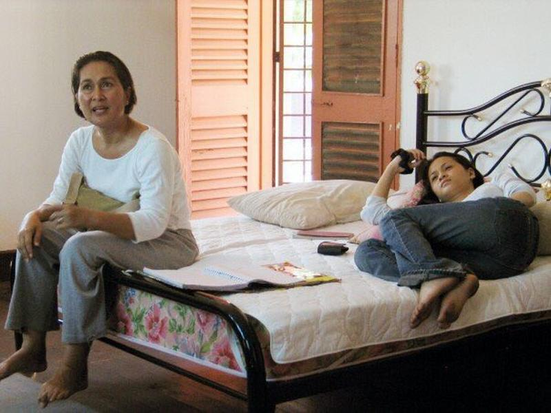 Director Yasmin Ahmad (left) and actress Sharifah Amani rehearsing a scene from the 2005 Malaysian film 'Sepet'. ― Picture via Twitter/Sharifah Amani