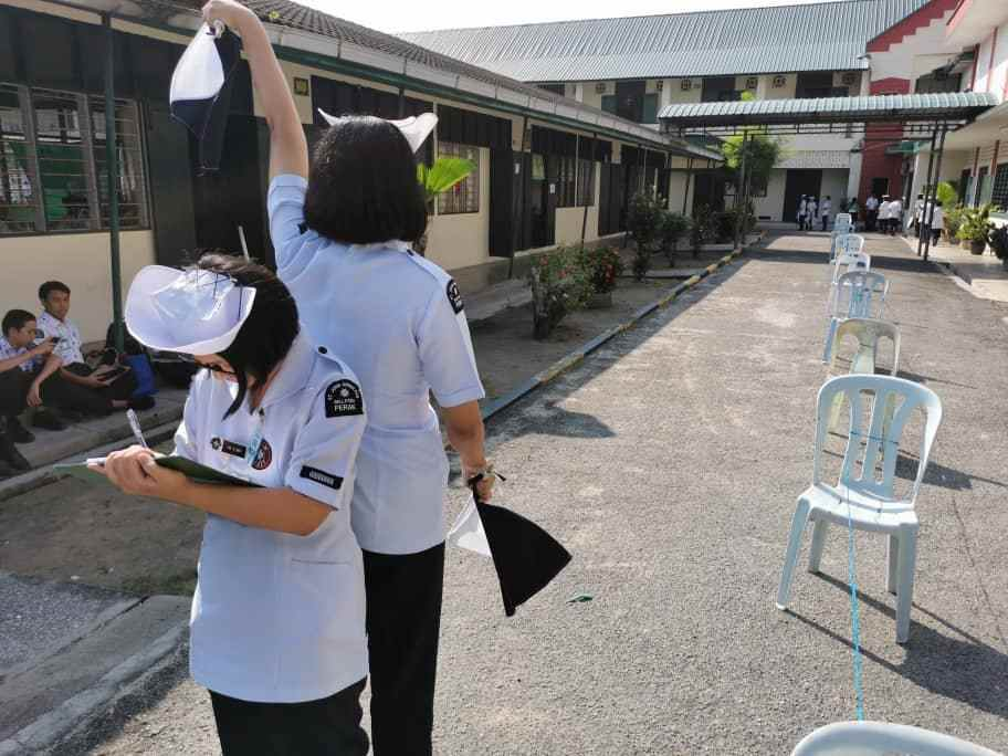 A flag signalling competition underway during the event organised by St John Ambulance Malaysia, Perak chapter. — Picture courtesy of St John Ambulance Malaysia, Perak chapter
