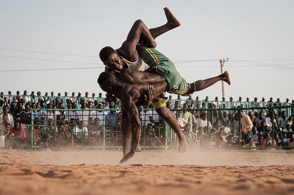 Sudanese wrestlers fight during a traditional Nuba wrestling match at the Haj Youssef stadium in the district of Khartoum. — AFP pic