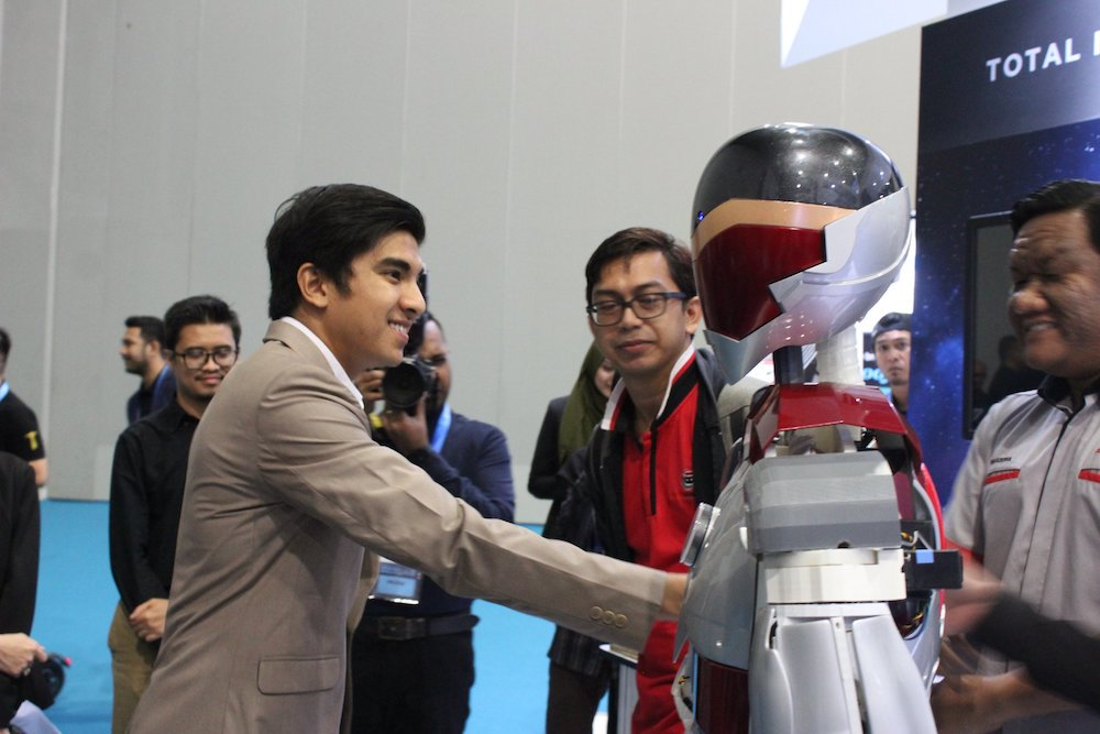 Youth and Sports Minister Syed Saddiq Abdul Rahman meets humanoid robot ADAM during the Beyond Paradigm Summit in Kuala Lumpur July 17, 2019. — Picture via Facebook/Robopreneurmy