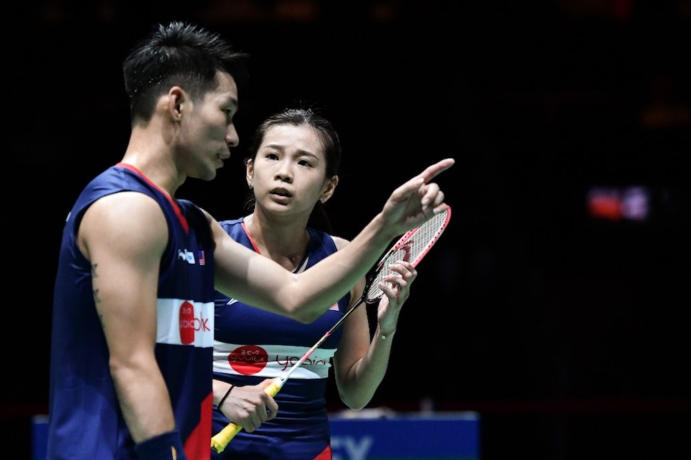 Malaysia's Chan Peng Soon and Goh Liu Ying react during their mixed doubles quarter-final match against Japan's Yuta Watanabe and Arisa Higashino during the 2019 BWF Badminton World Championships in Basel August 23, 2019. — AFP pic