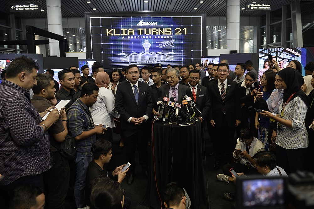 Prime Minister, Tun Dr Mahathir Mohammad speaks to reporters during the 21st Anniversary celebration of the KL International Airport in Sepang August 13, 2019. — Picture by Miera Zulyana