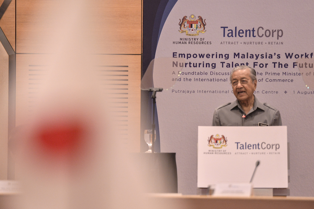 Prime Minister Tun Dr Mahathir Mohamad delivers his speech during a roundtable discussion with international chambers of commerce at the Putrajaya International Convention Centre August 1, 2019. — Picture by Shafwan Zaidon