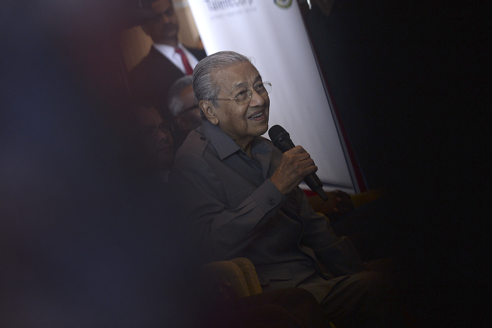 Prime Minister Tun Mahathir Mohamad speaks during a press conference after a roundtable discussion with international chambers of commerce at the Putrajaya International Convention Centre August 1, 2019. — Picture by Shafwan Zaidon