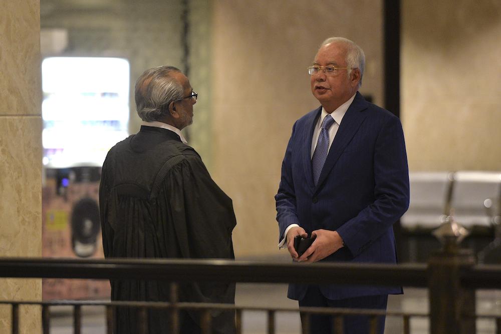 Datuk Seri Najib Razak confers with his lawyer, Tan Sri Muhammad Shafee Abdullah, at the Palace of Justice in Putrajaya August 13, 2019. — Picture by Shafwan Zaidon