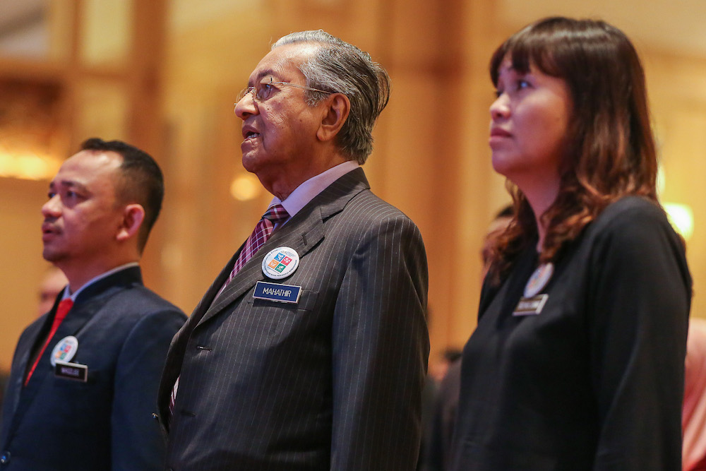 Education Minister Maszlee Malik, Prime Minister Tun Dr Mahathir Mohamad and Deputy Education Minister Teo Nie Ching attend the national civics education launch in Putrajaya August 13, 2019. — Picture by Yusof Mat Isa