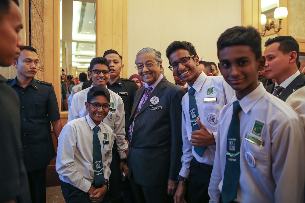 Prime Minister Tun Dr Mahathir Mohamad takes a photo with a group of students during the national civics education launch in Putrajaya August 13, 2019. — Picture by Yusof Mat Isa