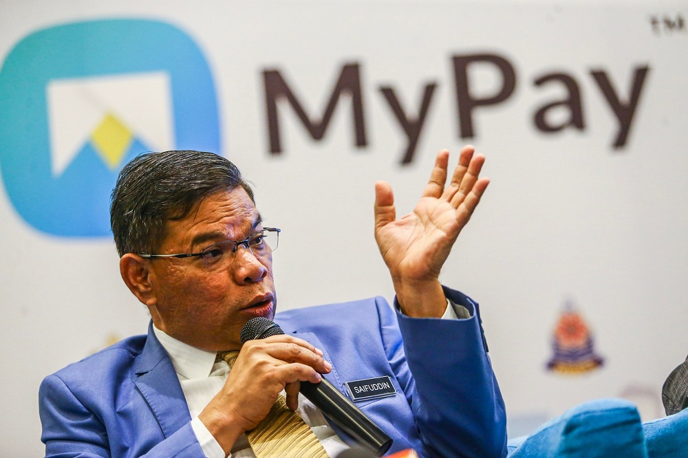 Domestic Trade and Consumer Affairs Minister Datuk Seri Saifuddin Nasution speaks during the launch of the MyPay Application at Dorsett Putrajaya August 15, 2019. — Pictures by Hari Anggara