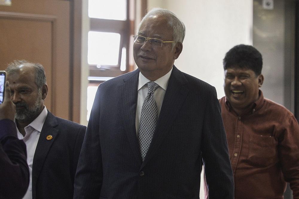 Datuk Seri Najib Razak arrives at the Kuala Lumpur High Court August 23, 2019. — Picture by Miera Zulyana