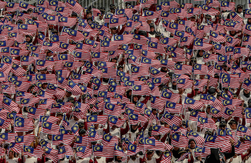 With the ongoing Covid-19 pandemic, moderation is the key to the launch of the National Month Celebrations and Fly the Jalur Gemilang Campaign. — Picture by Firdaus Latif