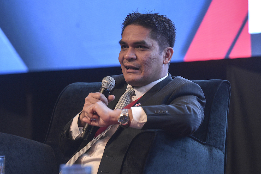 Deputy Economic Affairs Minister Radzi Jidin speaks during the National Economic Forum 2019 in Kuala Lumpur August 29, 2019. — Picture by Shafwan Zaidon