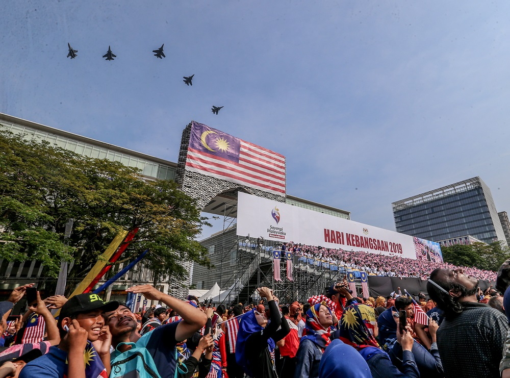 Malaysian Royal Air Force fighter jets fly above the crowd during the National Day Parade held at Dataran Putrajaya August 31, 2019. — Picture by Firdaus Latif