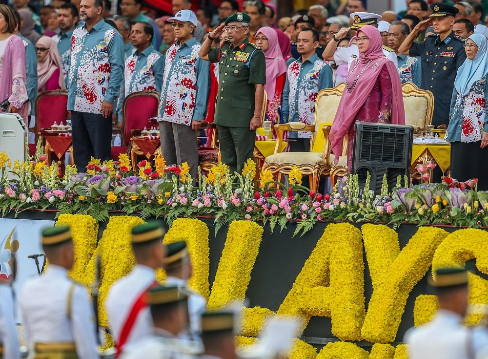 Yang di-Pertuan Agong Al-Sultan Abdullah Ri'ayatuddin Al-Mustafa Billah Shah, Prime Minister Mahathir Mohamad and Cabinet ministers attend the National Day Parade in Kuala Lumpur August 31, 2019.—Picture by Firdaus Latif