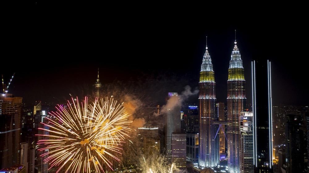 Fireworks are seen over the KLCC Twin Tower during the National Day celebration in Kuala Lumpur August 31, 2019. — Bernama pic