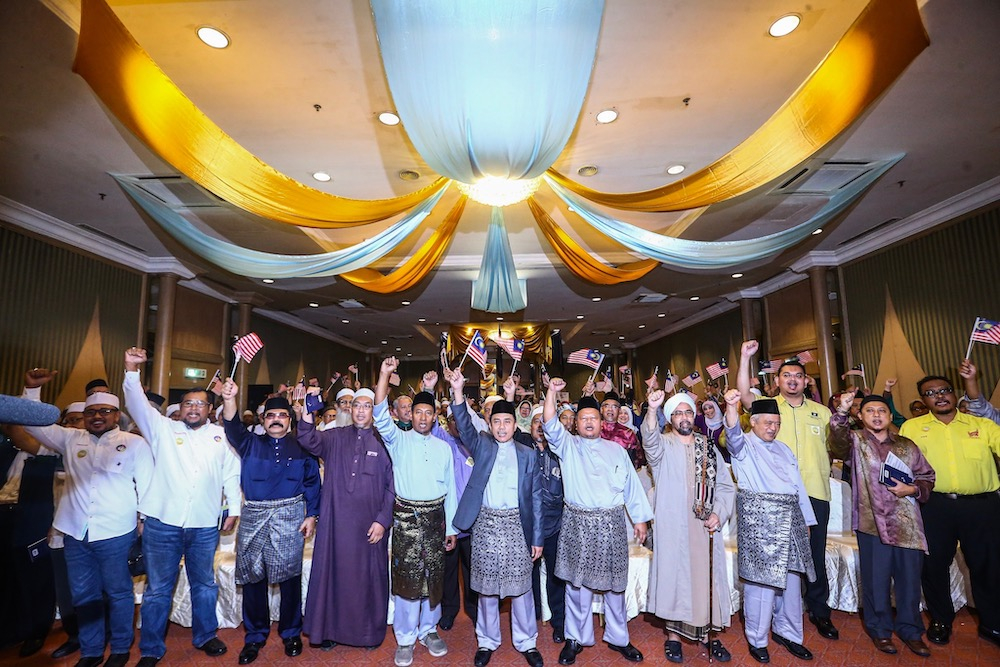 Ummah Chairman Aminuddin Yahya (centre) takes a group photo with speakers and representatives after the Ummah National Unity Convention at Kuala Lumpur International Hotel, August 25, 2019. — Picture by Hari Anggara