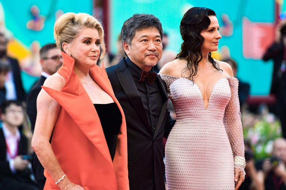 From left: French actress Catherine Deneuve, Japanese director Hirokazu Kore-eda and French actress Juliette Binoche arrive for 'The Truth' presented in competition at the 76th Venice Film Festival August 28, 2019. — AFP pic