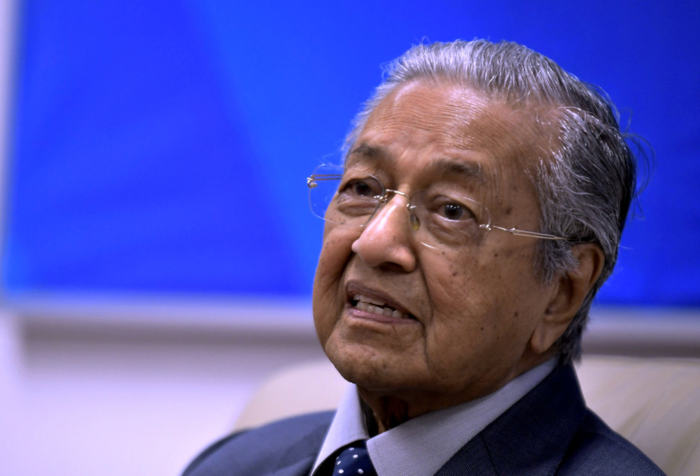Prime Minister Tun Dr Mahathir Mohamad answering a question by a Malaysian media personnel during a press conference before ending his official three-day visit to Hanoi Vietnam August 28, 2019. — Bernama pic