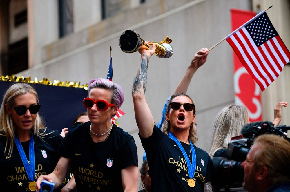 Megan Rapinoe (centre) and members of the World Cup-winning US women's football team take part in a ticker tape parade for the women's World Cup champions in New York July 10, 2019. — AFP pic