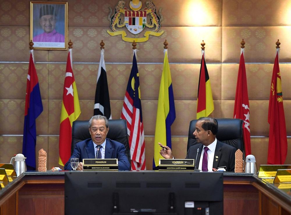Home Minister Tan Sri Muhyiddin Yassin (left) and Human Resources Minister M. Kulasegaran during a meeting in Putrajaya August 8, 2019. -- Bernama pic