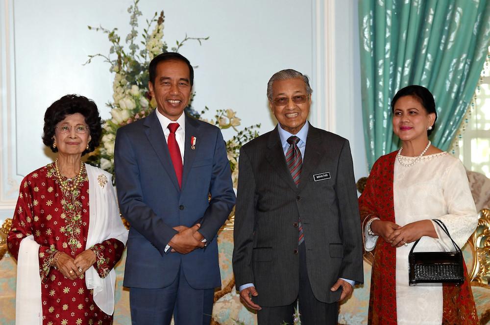 (From left) Tun Dr Siti Hasmah Mohd Ali, Joko Widodo, Tun Dr Mahathir Mohamad and Iriana Joko Widodo pose for pictures in Putrajaya August 9, 2019. — Bernama pic