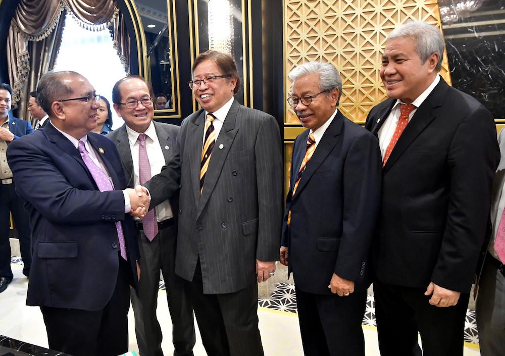 Sarawak Chief Minister Datuk Patinggi Abang Johari Openg shakes hands with Datuk Jaul Samion in Kuching August 22, 2019, following his appointment as Sarawak state secretary. — Bernama pic