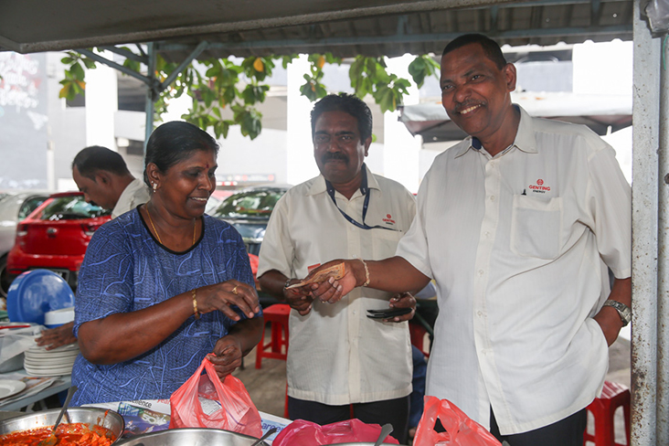 The stall has many regulars like Chandra Segaran (middle) and Mogan Sathia Sivam (right) who have been eating here since 1985!
